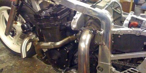 Image of Work under way on exhaust system for turbocharged Suzuki GSXR